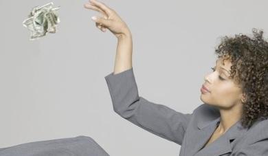 woman-throwing-money-away